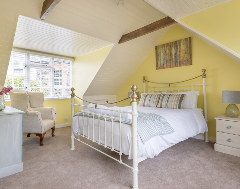 The pretty king size bedroom on the second floor at self catering holiday cottage, Poplar, in Port Issac.