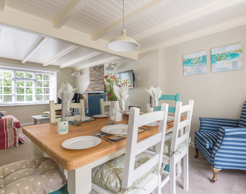 There are  plenty of places to sit for eating or relaxing at either end on the open plan living/dining room in Poplar Cottage in Port Isaac.