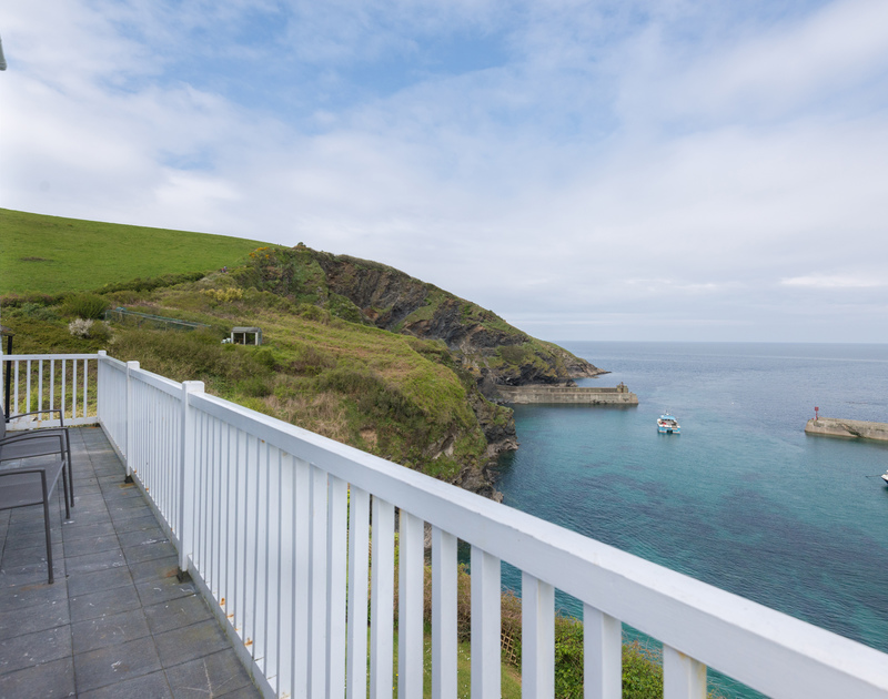 The long narrow balcony at Northcliffe enjoys views of the sea flanked by Lobber and Port Isaac's village