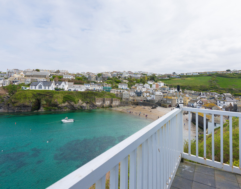 Looking over beautiful old village and working harbour of Port Isaac from Northcliffe's balcony