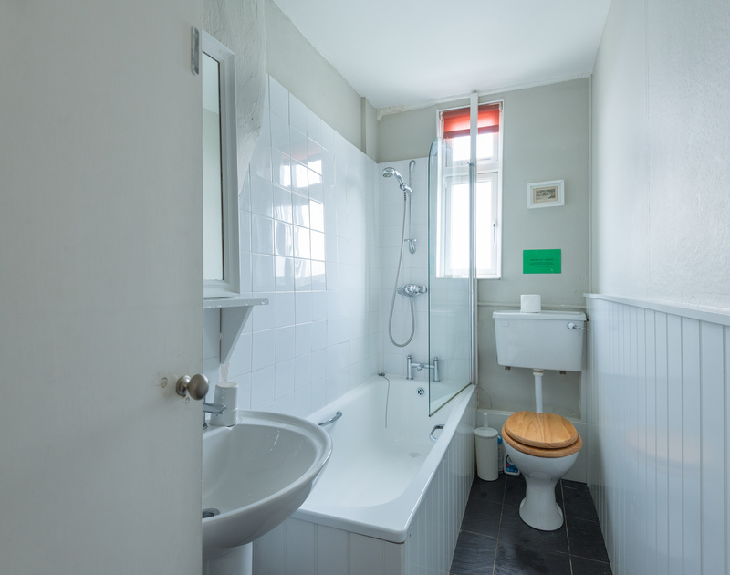 The bathroom is on the ground floor at Northcliffe, with shower over bath