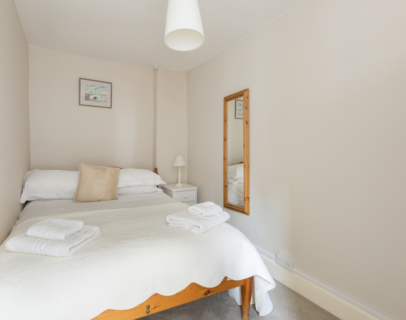 Snuggle up in the cosy double bedroom at Northcliffe, self-catering holiday rental in Port Isaac