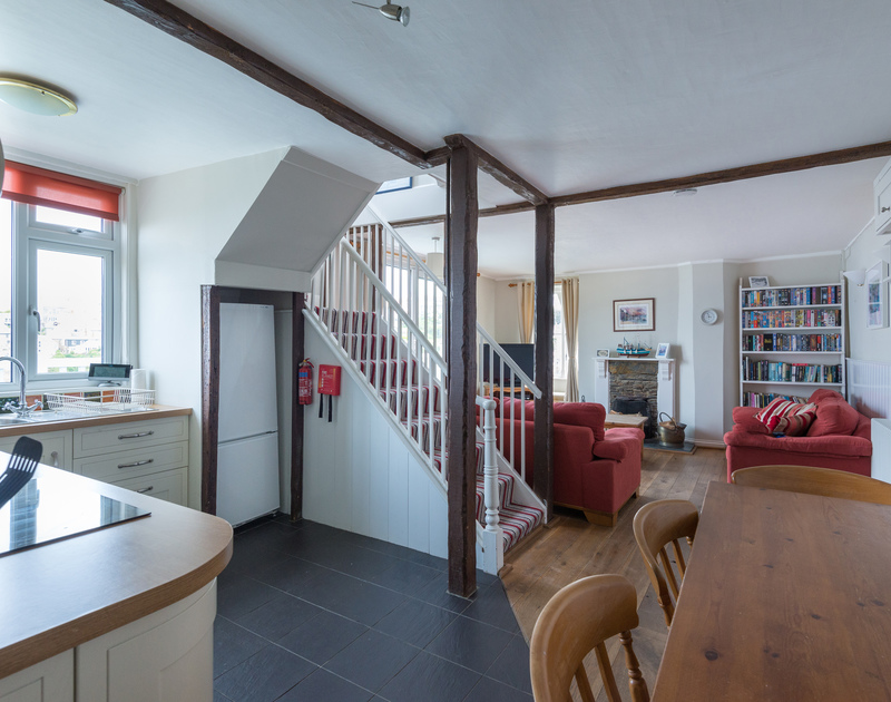 The living space at Northcliffe, with corner kitchen area and dining table leading through to the sitting room.