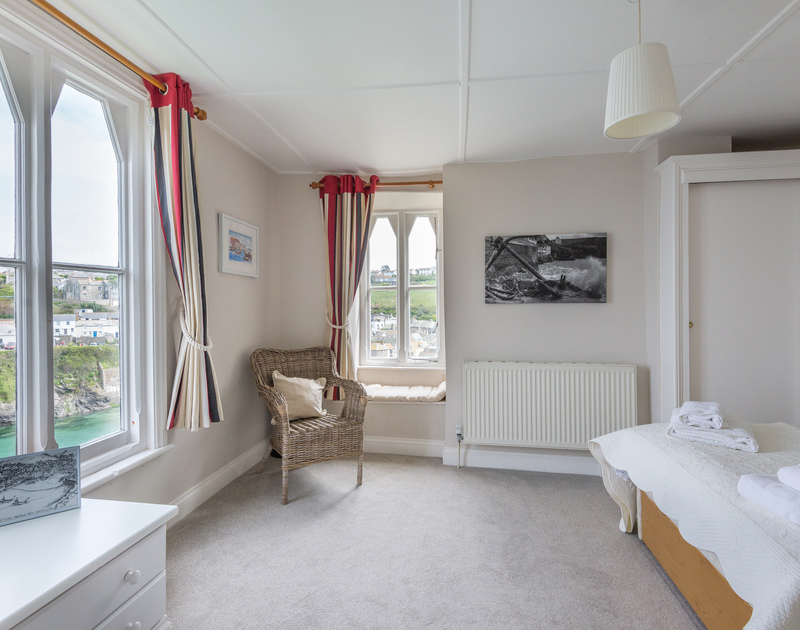 Low picture windows allow views from the bed in the master bedroom at Northcliffe