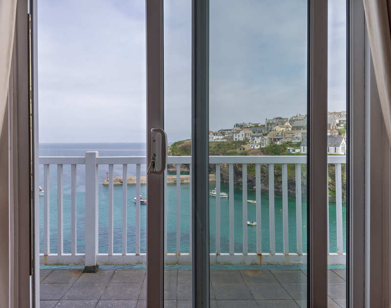 Sliding doors to the balcony of Northcliffe, with fabulous harbour and sea views