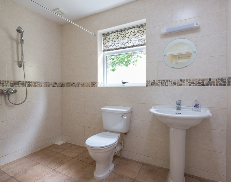 The neutral designed wet room at Pencreek, a traditional self catering holiday cottage in Rock, Cornwall