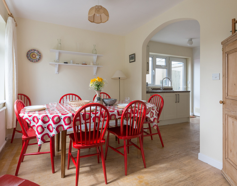 The bright, dining room at Pencreek, a self catering holiday bungalow to rent in Rock, Cornwall.