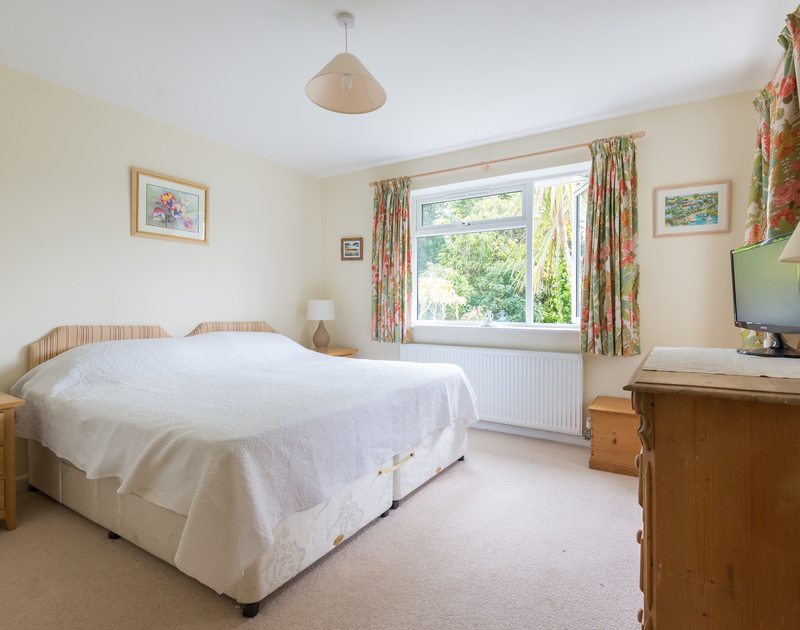 The master bedroom with a zip and link bed for flexibility where you can relax in front of the TV at Pencreek, a traditional self catering holiday cottage in Rock, Cornwall