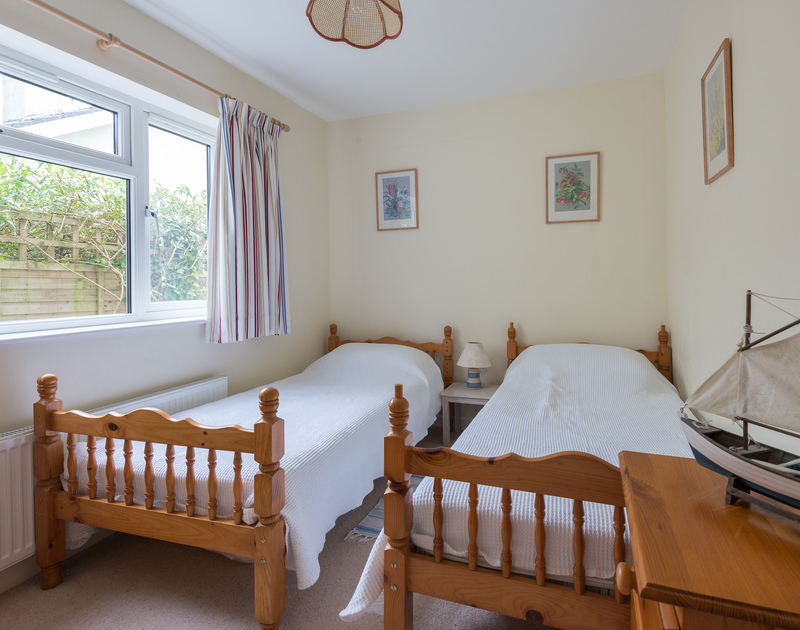 One of the twin bedrooms in Pencreek, a self catering, holiday rental in popular Rock on the North Cornish Coast.