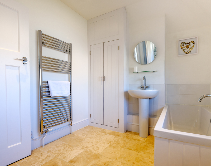 The spacious family bathroom with separate walk in shower at the Moorings in Rock, Cornwall