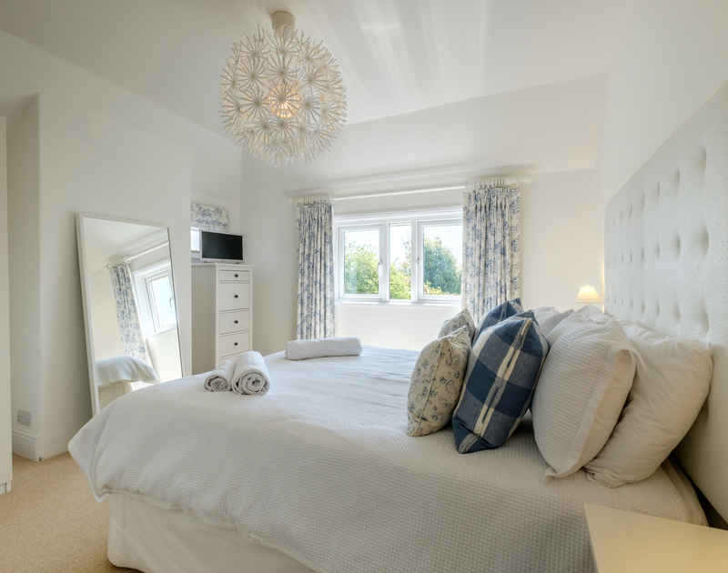 Enjoy a good nights rest in the master bedroom suite at The Moorings, a self catering holiday cottage in Rock, Cornwall