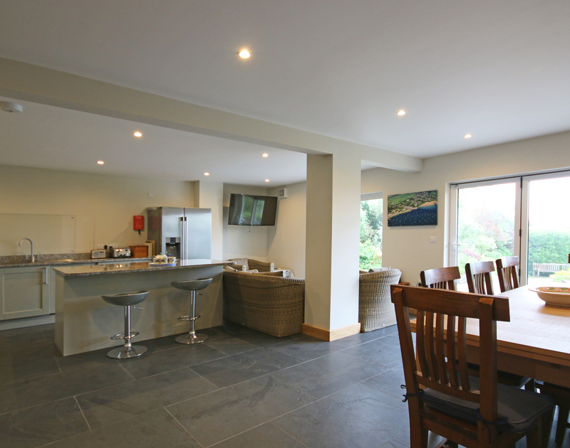 The enormous open plan kitchen dining room at Greywings in Rock, opens out onto a terrace for outdoor dining