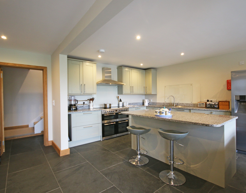 The ground floor open plan kitchen at Greywings, a self catering holiday house in Rock, is light and bright