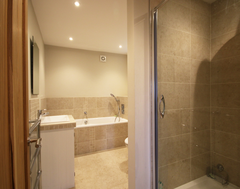 The stylish master ensuite at Greywings in Rock, Cornwall has a separate shower and bath