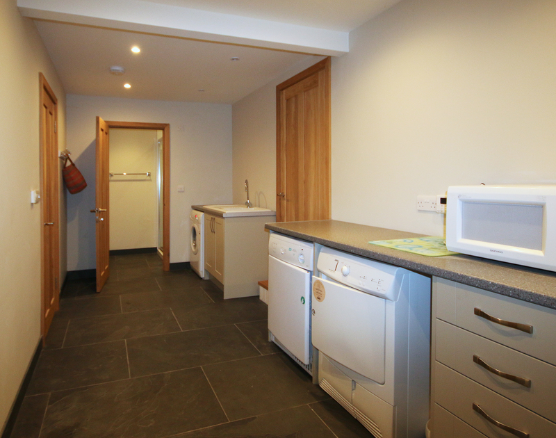 The ground floor utility room at Greywings is huge with a useful shower room to help keep the sand at bay