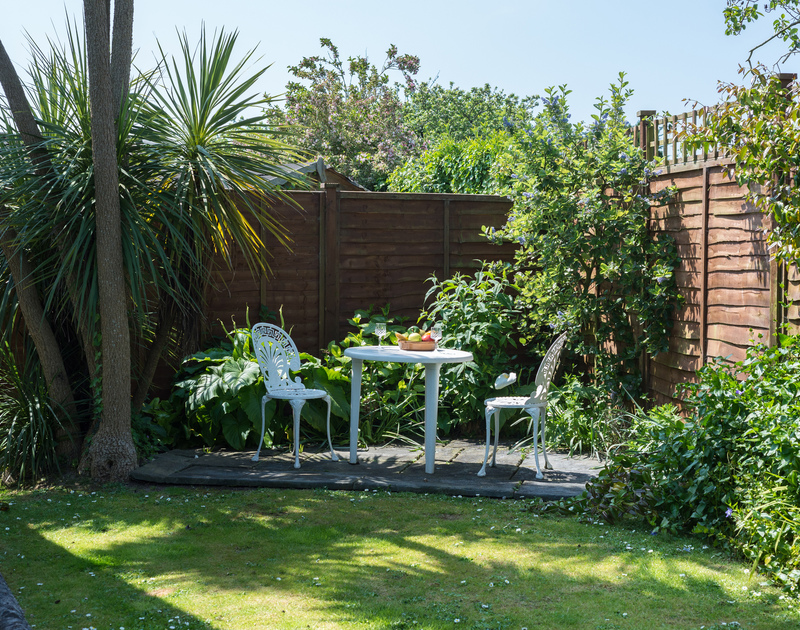 Read a book or simply sit and relax at this little corner patio in the garden of Caerhayes