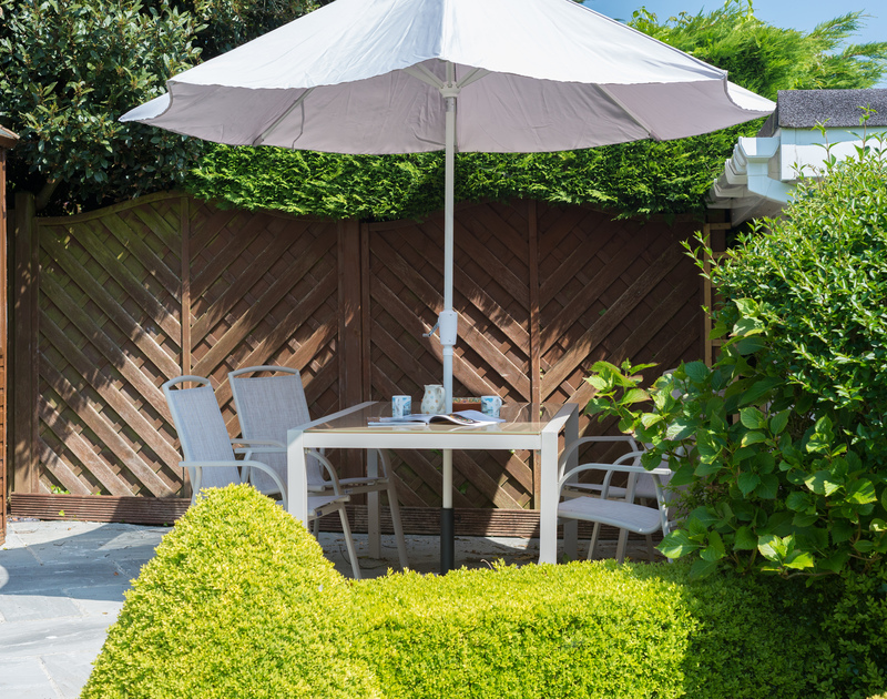 A chance of alfresco dining on the sunny paved terrace at Caerhayes, a well-positioned holiday house in Rock