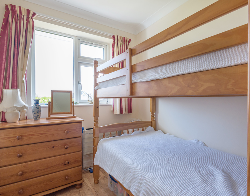 Pine bunk beds with matching chest of drawers in the bunk room of Caerhayes, great fun for children to share.