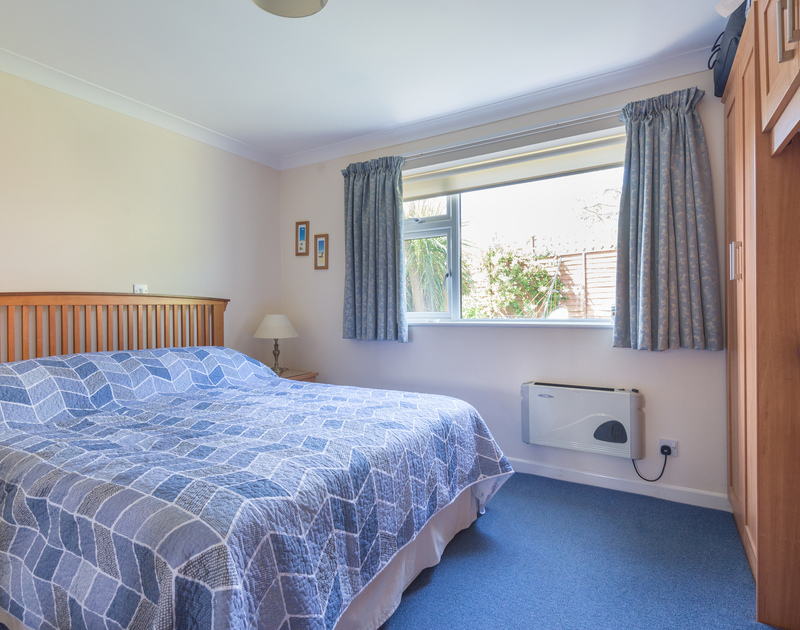 One of two double bedrooms at Caerhayes, this one with blue furnishings.