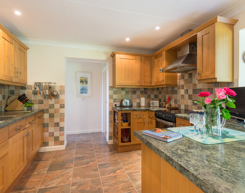 The attractive kitchen of Caerhayes, a self-catering holiday house in Rock, Cornwall