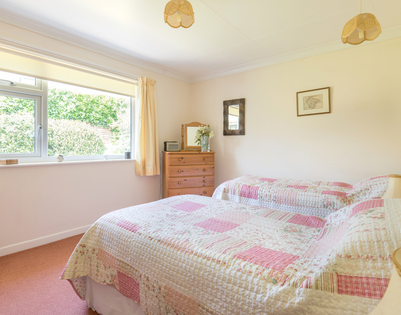 Pink themed twin room with matching bedspreads at Caerhayes, a holiday rental in Rock