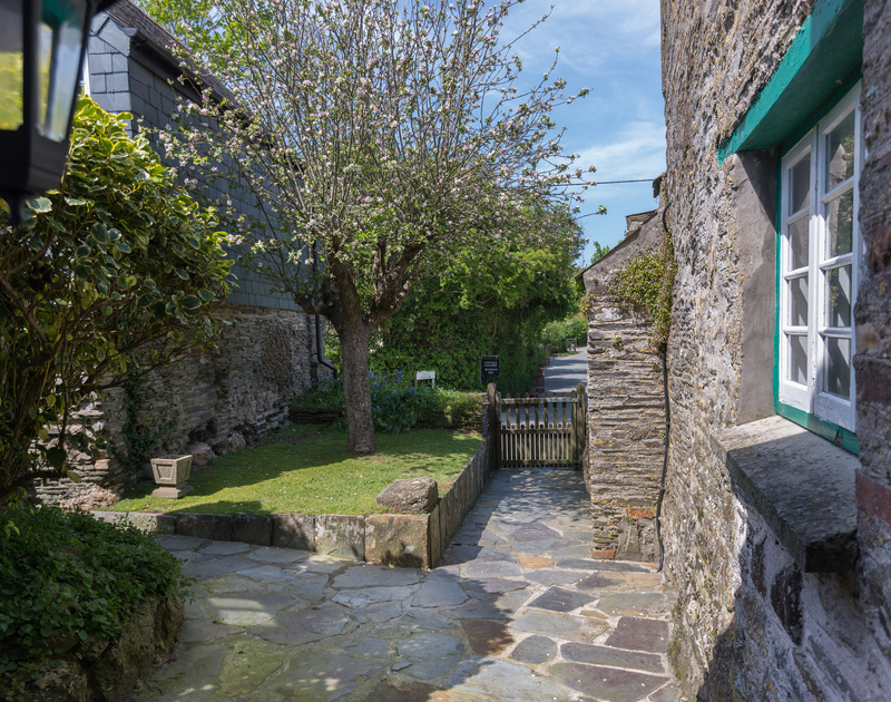 Path to the front door of Porthilly Greys, a charming traditional holiday rental in Rock, with lane to the beach beyond