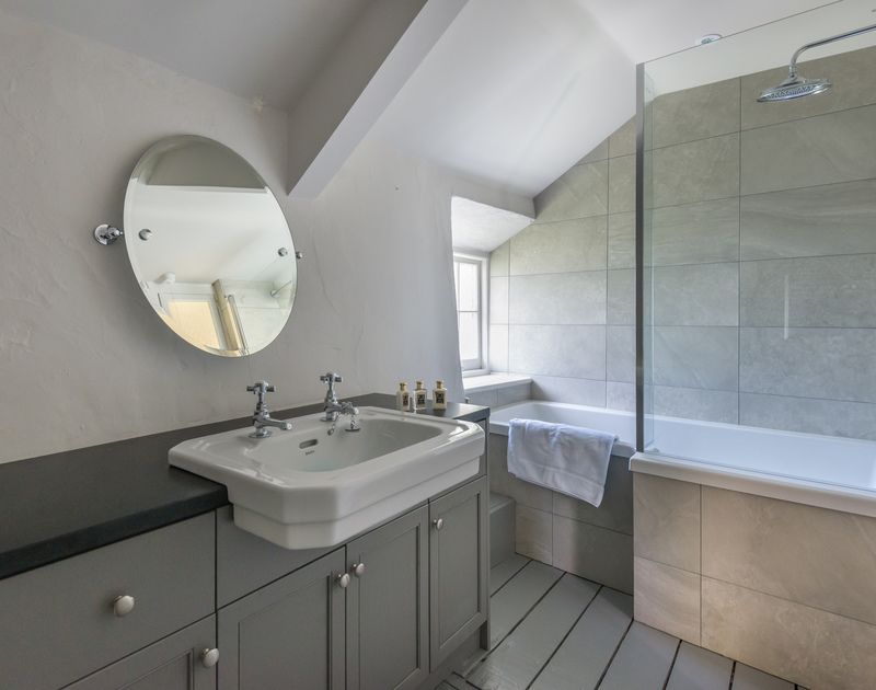 Gorgeous new bathroom with large 'rain shower' head over the bath and glass screen.