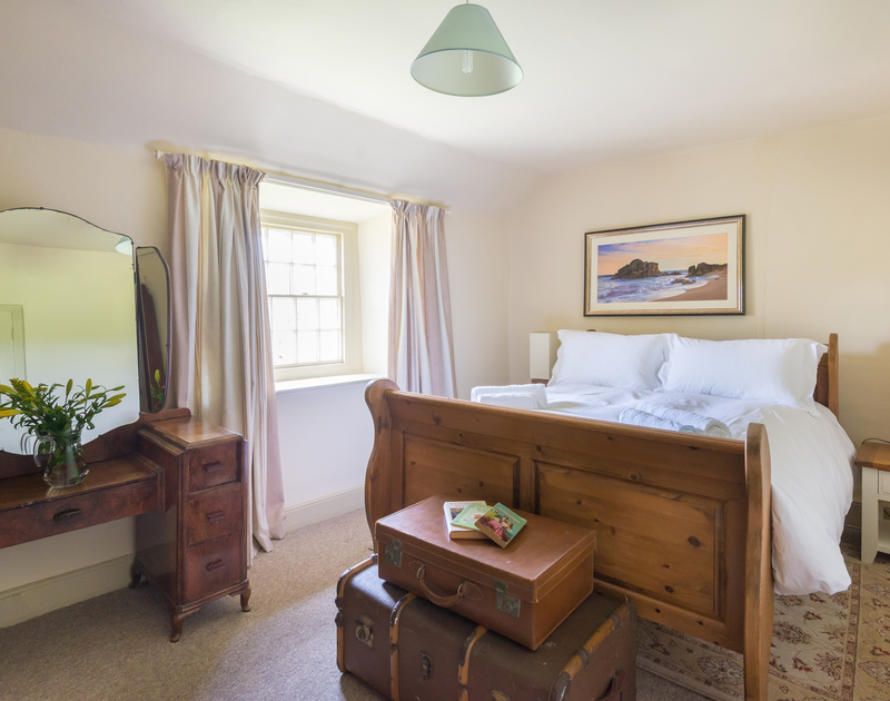 Traditional furniture and a lovely sleigh bed in a double bedroom of Porthilly Greys, a holiday let in Rock