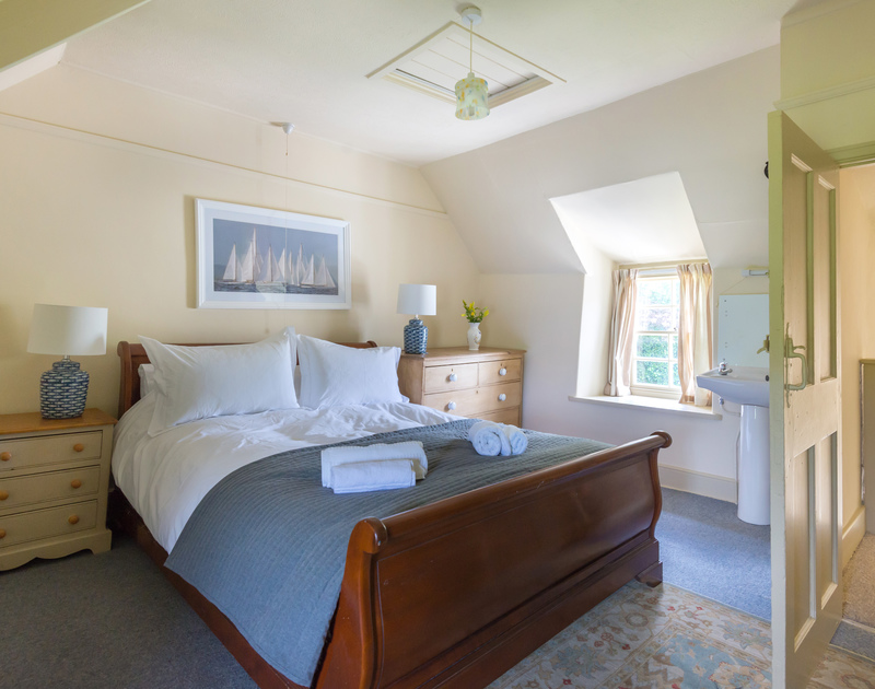 A well furnished double bedroom at Porthilly Greys, with gorgeous wooden sleigh bed