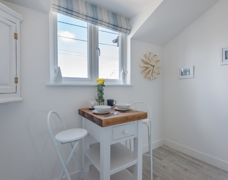 A convenient spot for breakfast or morning coffee with views over Roscarrock Hill and the village at Port Isaac.