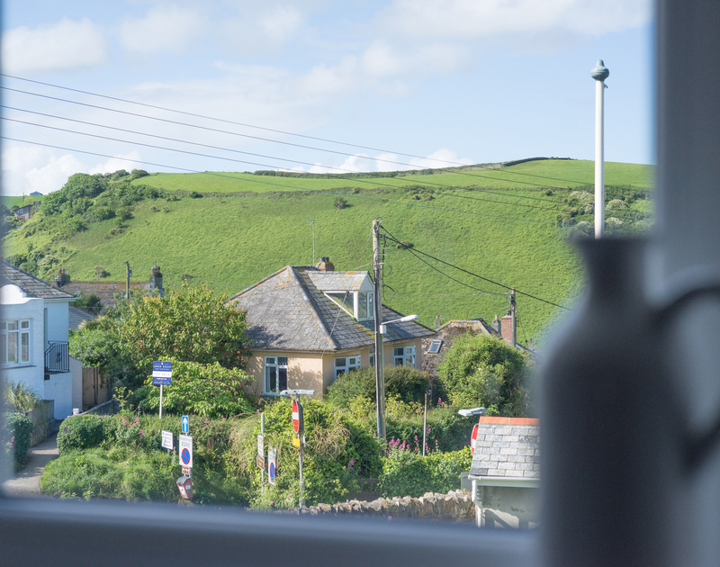 Village and rural views out to Roscarrock Hill from the kitchen at self catering holiday property Pendragon House.