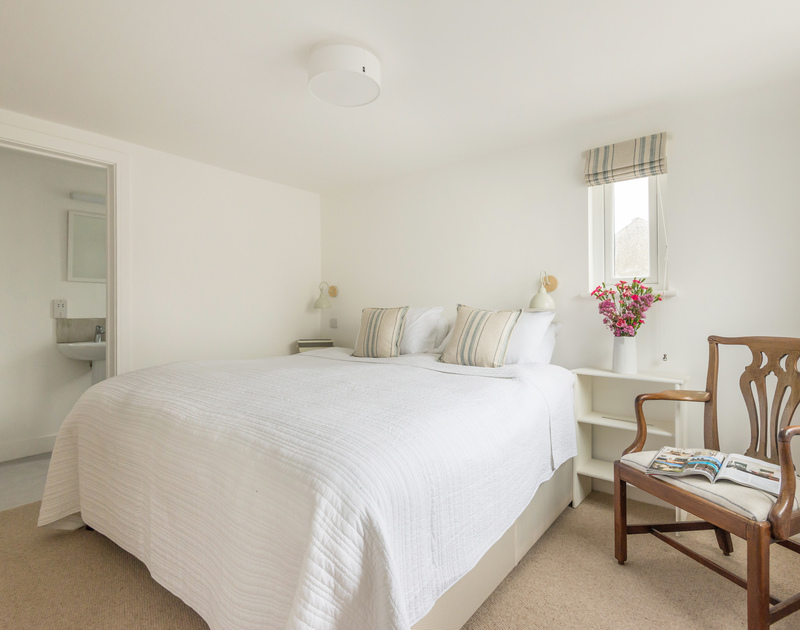 Comfortable Superking bedroom with ensuite at Pendragon House a self catering holiday property in Port Isaac, north Cornwall.