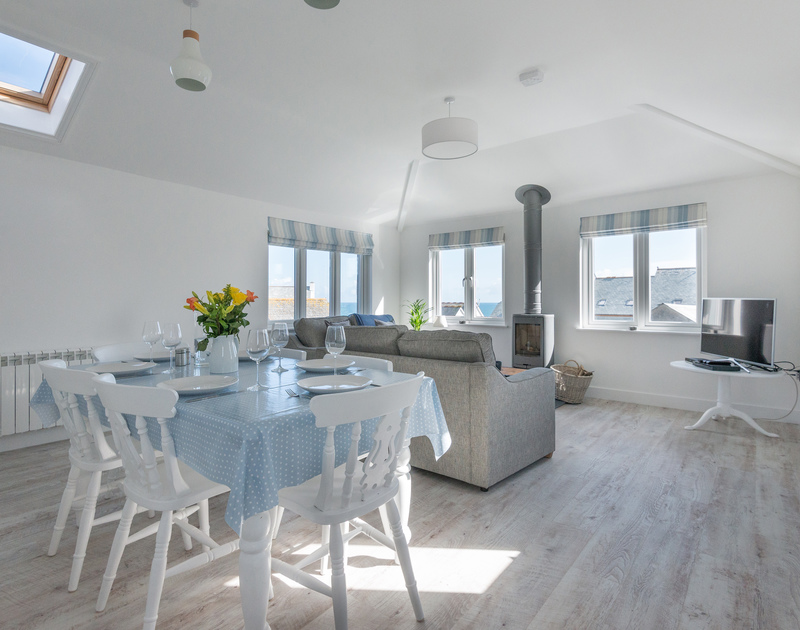 Gather the family around the dining table to enjoy home cooked meals around the dining table at Pendragon House, Port Isaac.
