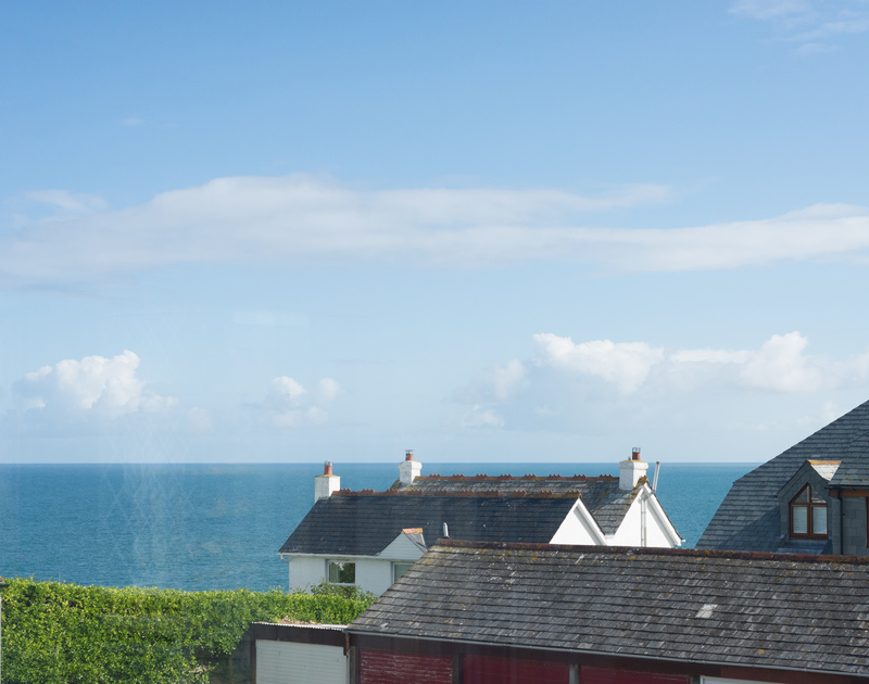 The reverse living at Pendragon House makes the most of the sea views from the sitting room's elevated position.