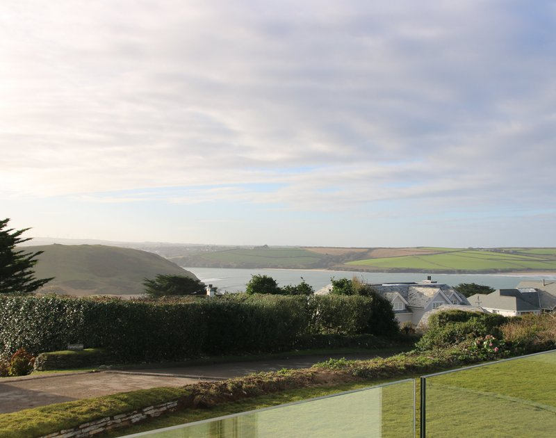 Far reaching views of Brea Hill and the Camel Estuary over towards Tregirls and Hawkers Cove from the balcony at Mordros, Greenaway.