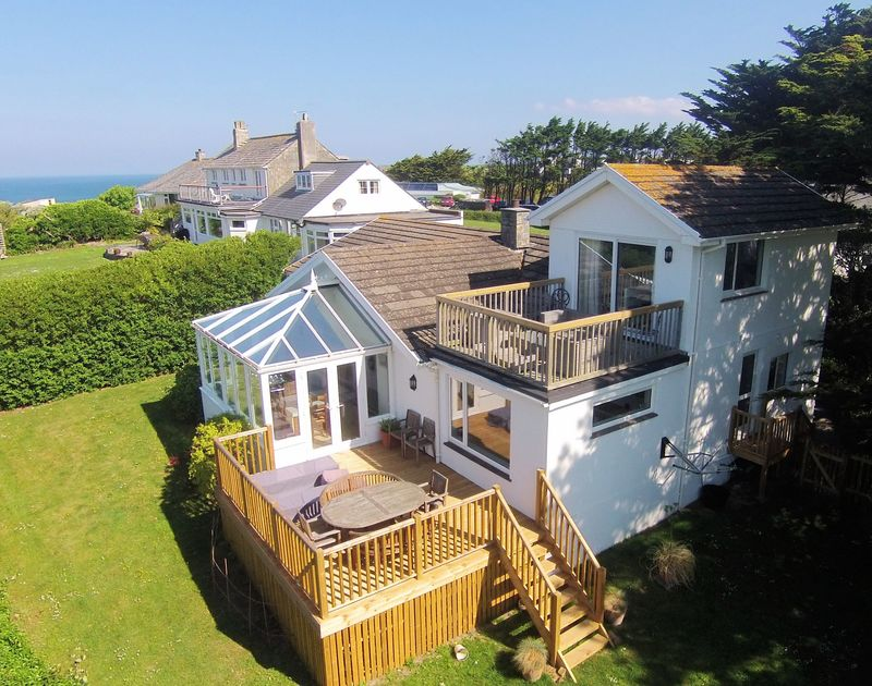 The spacious coastal property Brae Heights in Daymer Bay, Cornwall, with a patio off the living room and the upstairs bedroom, walking distance to the beaches
