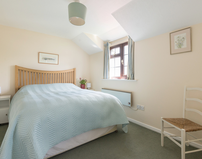One of two double bedrooms at Hazelhurst, a holiday cottage near Rock