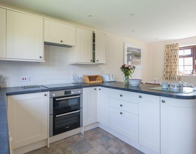 Practical, modern and easy to clean kitchen at Hazelhurst, self-catering in Rock