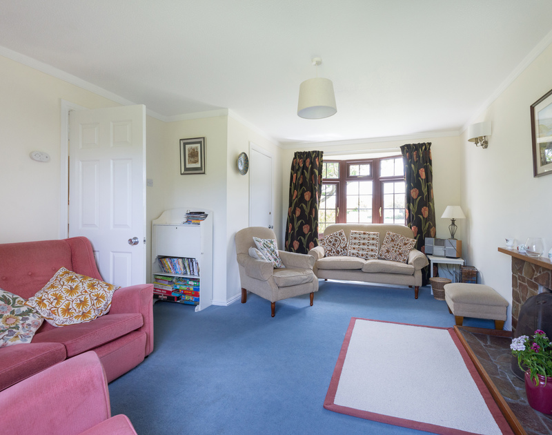 Choose from 2 sofas and 2 armchairs in the sitting room of Hazelhurst, a great value holiday rental near Rock