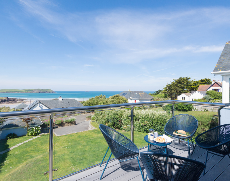 Relax and drink in the breathtaking sea views on the balcony at Bryher - a luxurious holiday cottage in Polzeath, north Cornwall