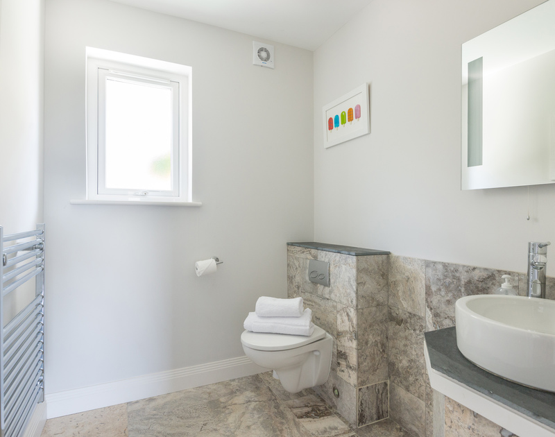 The ground floor cloakroom at Bryher in Polzeath is convenient for access to the garden, terrace and TV room
