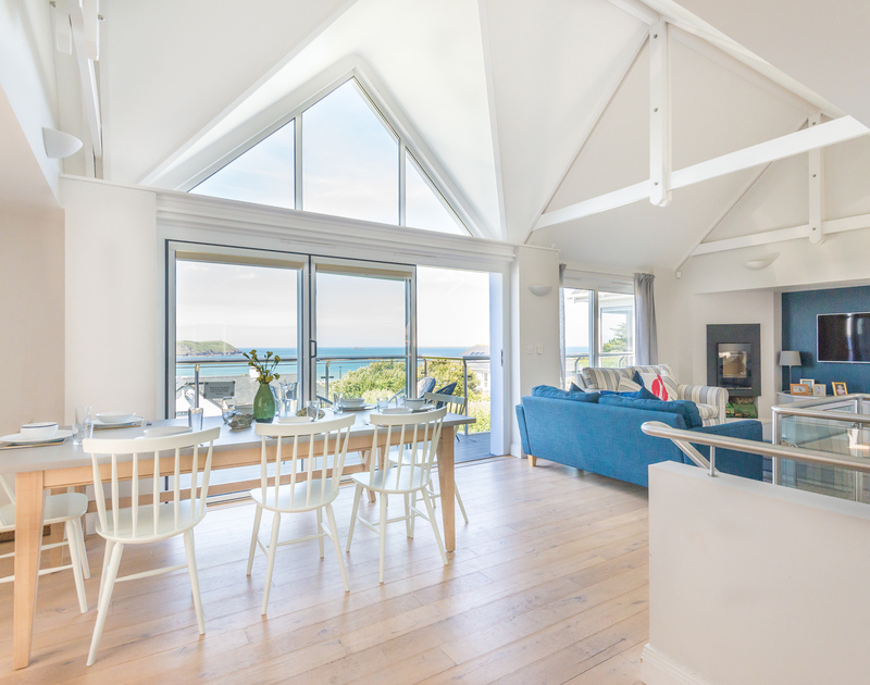 Seaviews from the spacious open plan living area of Bryher, a holiday house in Polzeath, Cornwall, with vaulted ceiling.