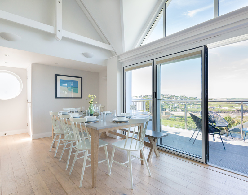 Bryher's light and airy dining area, with vaulted ceiling and glass doors to its large balcony
