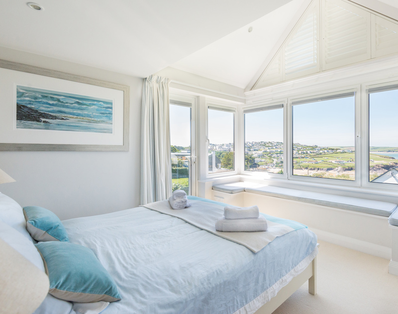 Enjoy beautiful views from the first floor master ensuite bedroom at Bryher, in Polzeath, Cornwall, with a large bay window seat.