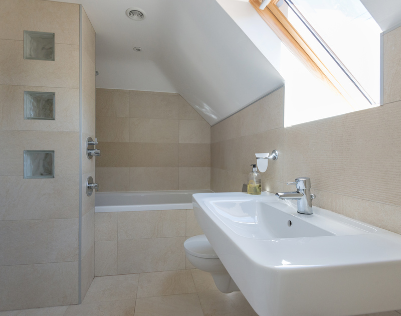A light filled and luxurious ensuite master bathroom at Bryher, a coastal holiday house to rent in Polzeath, Cornwall.