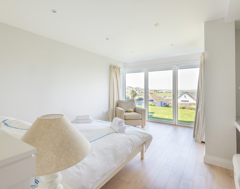 Glass doors to the garden from the double bedroom of Bryher, stunning holiday rental in Polzeath