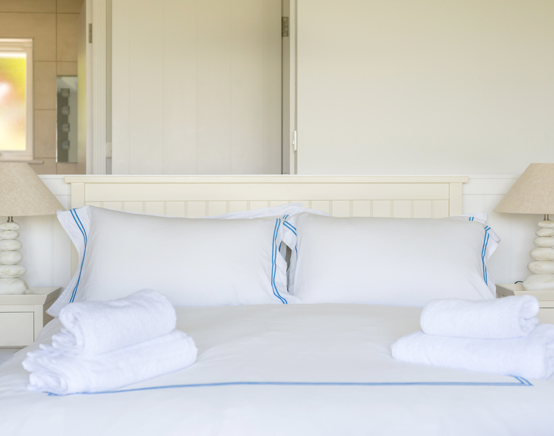 Plump pillows and fresh linens in the ground floor double bedroom at Bryher