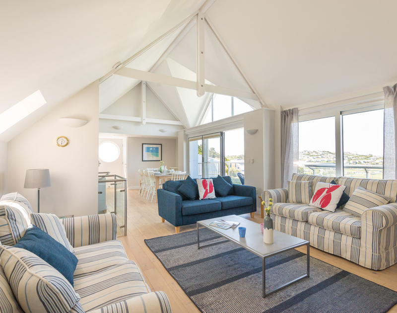 The spacious sitting room of Bryher, a self-catering seaside holiday house in Polzeath, Cornwall