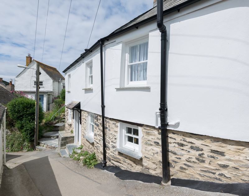 Enjoy wandering the narrow winding lanes of Port Isaac to fine Bre Cottage, an old fisherman's cottage perched on a hill leading down to the Harbour