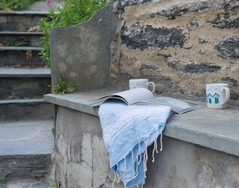Rest on the slate bench next to steps in the garden of Bre Cottage